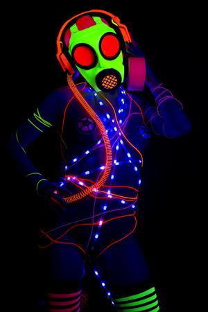 sexy UV neon disoc woman weatring flourescent gasmask.