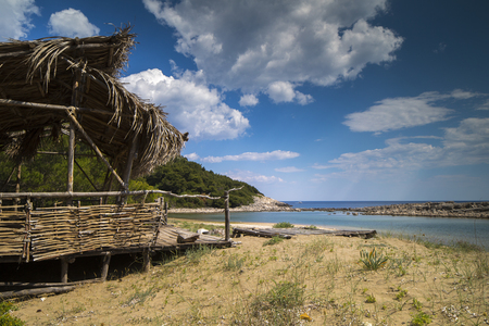 a wooden shack on beautiful limoni beach in mljet island, croatia with stunning crystal clear water of the adriatic sea.