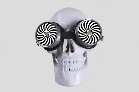 halloween skull with hypnotic pattern glasses Imagens