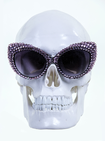 skull with vintage sparkling sunglasses