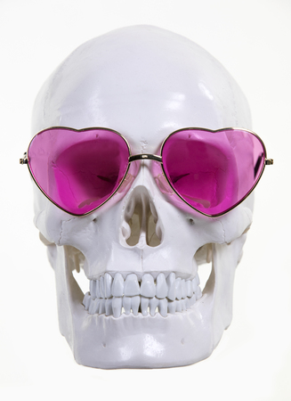 skull with pink heart shaped sunglasse