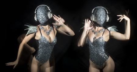 amazing woman dancing in diamond covered face mask and costume
