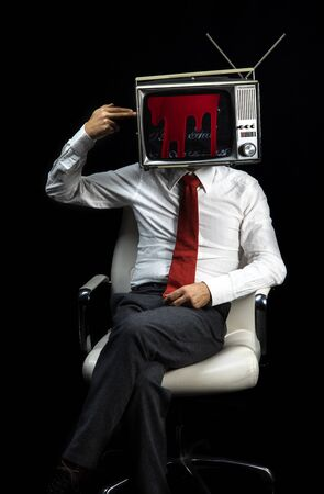 smart businessman with a television as a head. he is shooting himself in the head with his fingers
