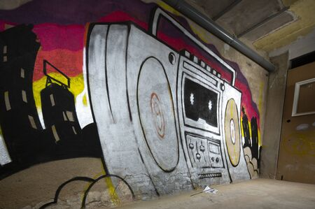 a unfinished graffii art work of a boom box ghettoblaster on a wall