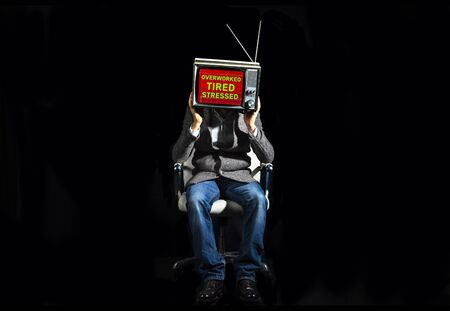smart businessman with a television as a head. the tv has the statement - overworked stressed tired animated on the screen