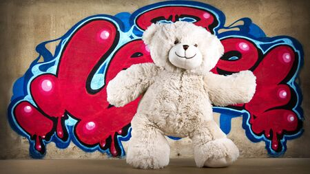 amazing funky teddy bear brought to life break dancing infront of a graffiti wall