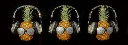 cool mr pineapple head with sparkling shades shades and headphones 版權商用圖片
