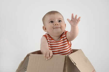 adorable small baby girl in a cardboard box Stock Photo