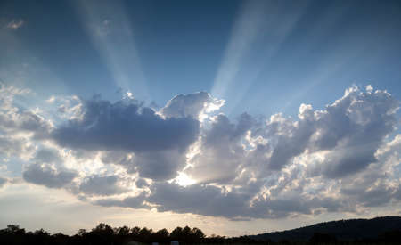 clouds with rays of sunlight in the sky