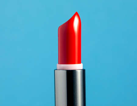 A red lipstick against blue