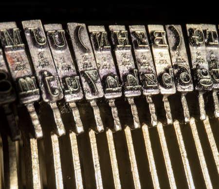 close-up shot of vintage typewriter hammers 스톡 콘텐츠