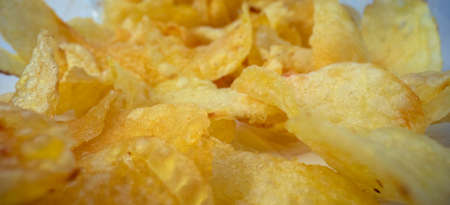Macro shot of potato chips in packet 스톡 콘텐츠