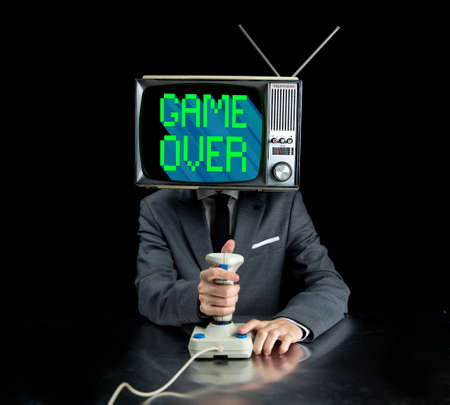 Man with TV on head playing video games 스톡 콘텐츠