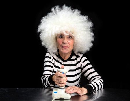 Gaming granny using joystick 스톡 콘텐츠