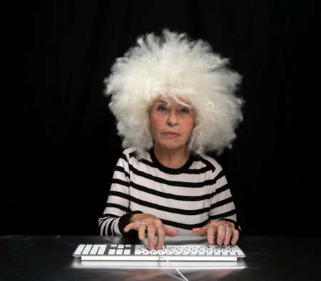 Granny typing on computer keyboard