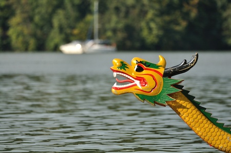 green boat: Head of dragon boat on the water