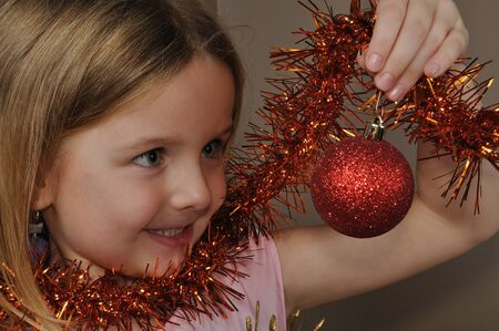 small girl with christmas decoration photo