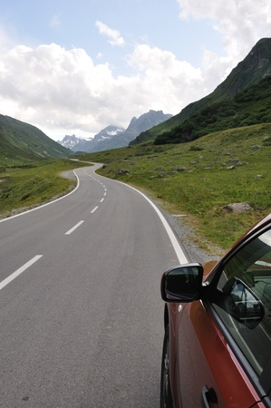 asphalt road in mountain with car photo