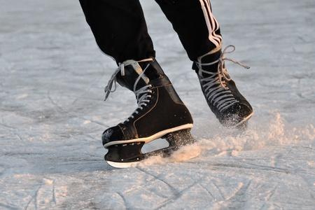 Closeup aggressive ice skating photo