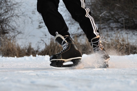 Closeup aggressive ice skating