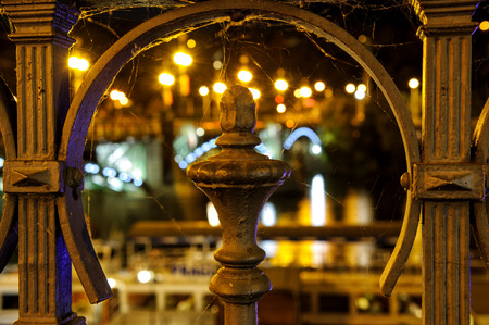 banisters: Detail view to steel banisters decoration with bridge lights in background close to riverbank and Svatopluk Cech Bridge.