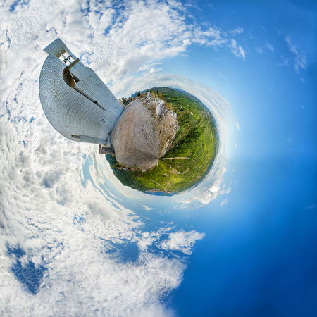 panoramatic: Panoramatic landscape in abstract 360 planet view like earth with dominant modern church and blue skye with nice clouds Stock Photo
