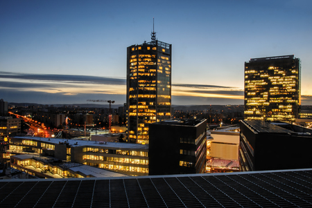 Skyscrapers in the night. Prague modern building architecture. Office and headquarters of succesfull bussiness companies.