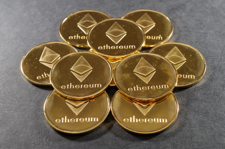 Stack of golden ethereum coins. Cryptocurrency background image.