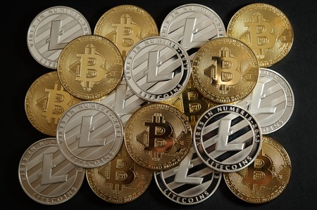 Mix of golden bitcoin and silver litecoin coins