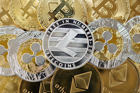 Golden and silver bitcoins, litecoins, etherum and ripple coins. Stock Photo