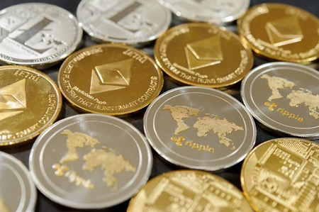 Stack of bitcoin, ripple, etherum and litecoin coins. Virtual currency concept. Stock Photo
