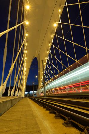 Public transport on modern bridge. Troja bridge in Prague. Stock Photo
