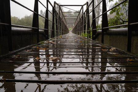 Metal bridge in the rain from bottom angle. 免版税图像