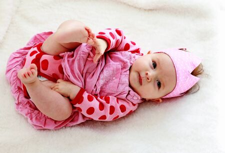little baby-girl in pink dress Stock Photo - 12111056