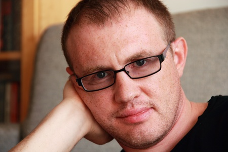 one mature man only: handsome young man with glasses Stock Photo