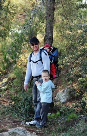 Father hiking with two children Stock Photo - 12097232
