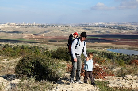 Father hiking with two children Stock Photo - 12112884