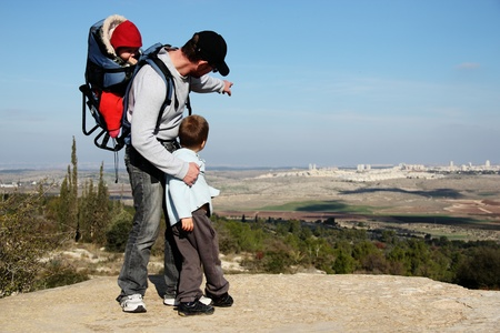 father and son during a hike looking at their hometown Stock Photo - 12097264