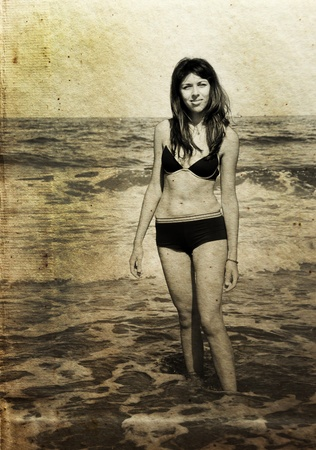 beautiful girl on the beach. Photo in old color image style. Stock Photo - 12112709