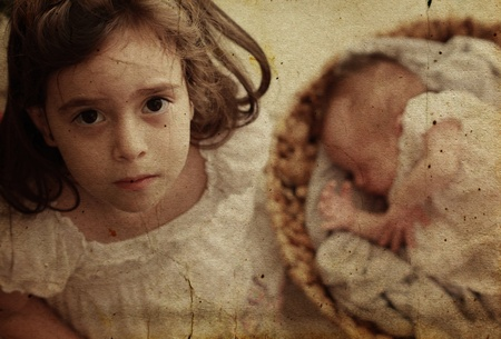 5-year-old girl with her newborn sister. Photo in old image style. photo