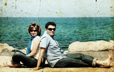 portrait of a happy family on the background of the sea. Photo in old image style. photo