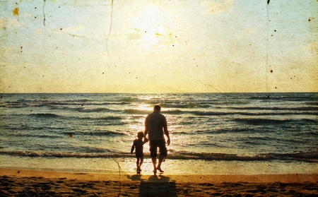 quiet adult: Father and son at sea watching the sunset. Photo in old image style.
