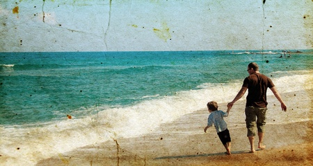 father and son playing together on the beach. Photo in old image style. photo