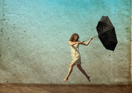 girl with umbrella. Photo in old color image style. photo
