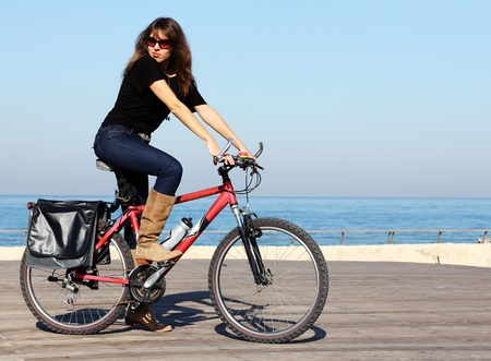 Beautiful woman with bicycle photo