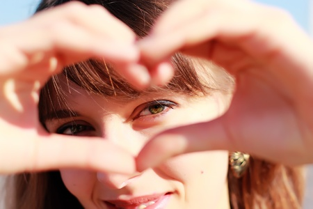heart healthy: Beautiful girl show love sign