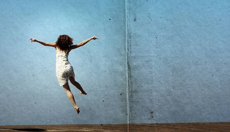 funny jump of young woman. freedom. photo