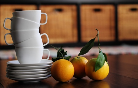 White cups and organic oranges. soft Focus photo
