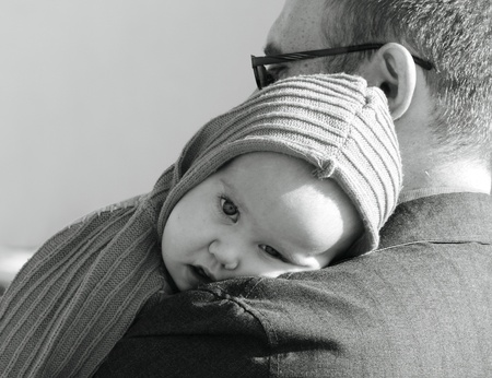 portrait of 10 month old girl and dad. Focus on the child. photo