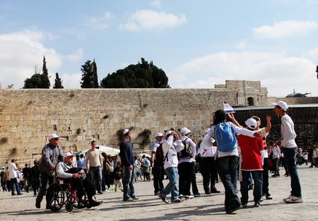 Jerusalem, Israel – November 3, 2011: Tourists and Israelis near the Western Wall in Old City of Jerusalem Stock Photo - 12385900